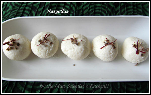 3 pieces of the rasgulla topped with saffron and cardamom
