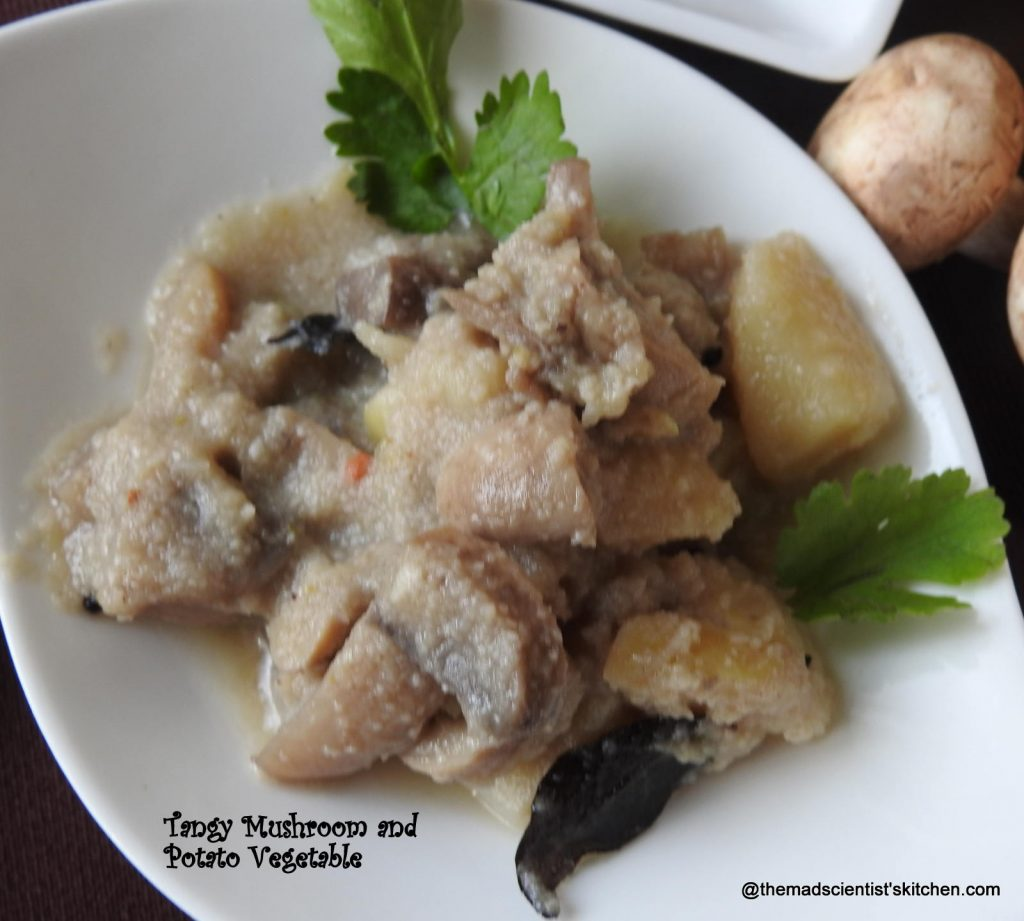Almi ani Batat che Ambat, Tangy Mushroom and Potato Vegetable Recipe