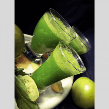 A green smoothie served with ice