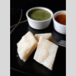 Idli, steamed dumpling, severed with green chutney and sambhar