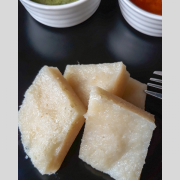 Simple beaten rice is steamed and served with chutney and sambhar