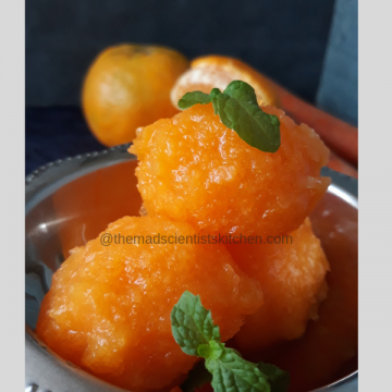 Granita from oranges and carrots served garnished with mint